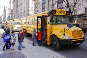 New York City USA - March 03 2011: Children entering school bus in the center of Vew Your City.